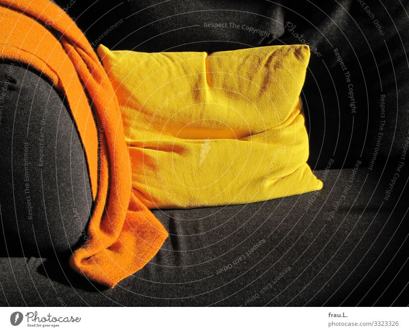 Sofa corner Living or residing Flat (apartment) Living room Yellow Orange Black Multicoloured Cushion Blanket Wool blanket Colour photo Interior shot