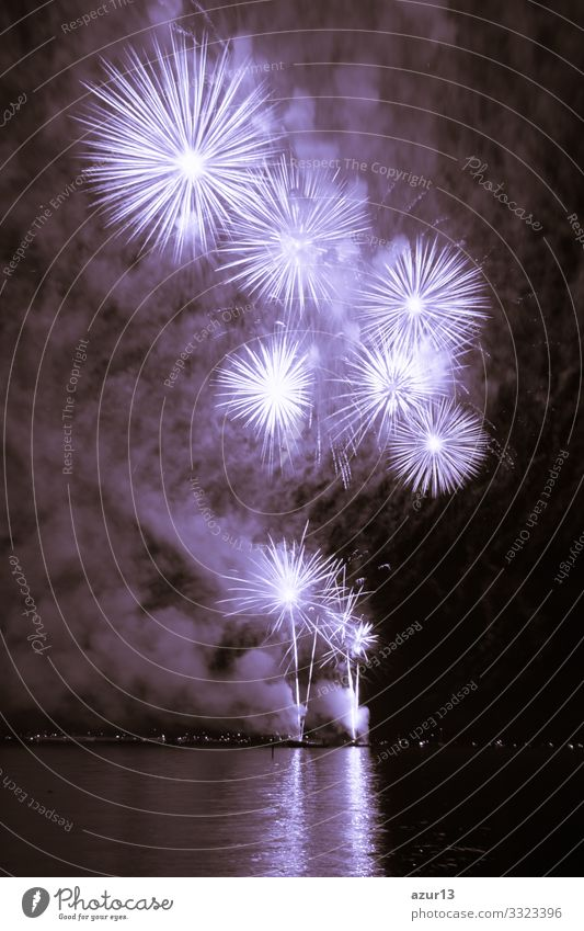 Luxury fireworks event sky water sea show with purple stars luxury entertainment party celebration celebrate festival nightlife pyrotechnics magic new year