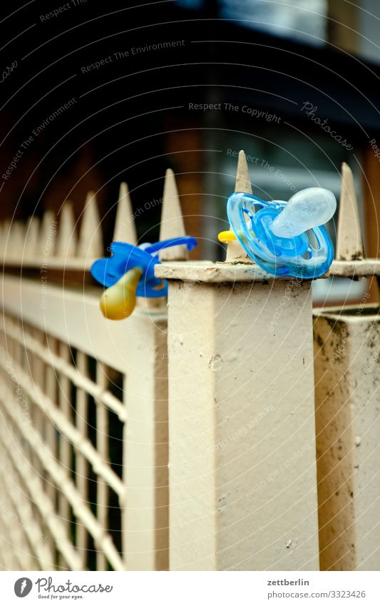 Two dummies Keep Baby Discovery site Find Real estate Child Kindergarten Toddler Soother Suck Mammal Doomed Fence 2 In pairs Deserted Copy Space Exterior shot