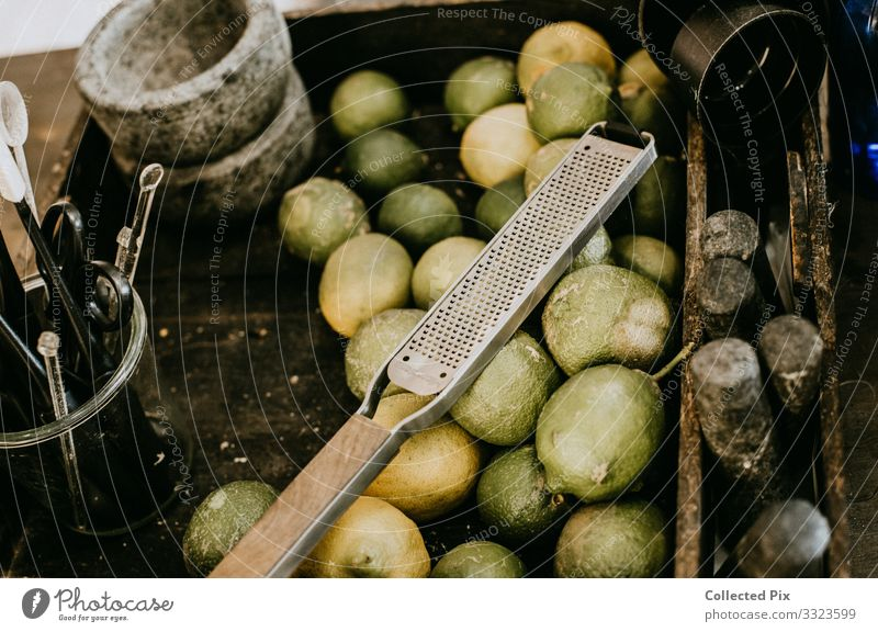 Limes in an industrial basket with grater Food Vegetable Fruit Crockery Bowl Lifestyle Healthy Feeding To enjoy Living or residing Esthetic Authentic Good