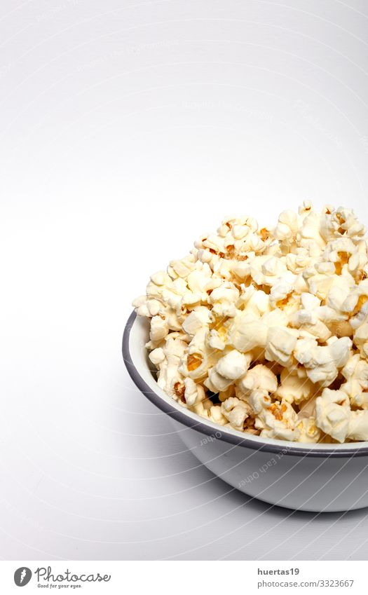 Popcorn on colored backgrounds Food Fast food Bowl Entertainment Cinema Fresh Delicious White Colour Snack Salty movie Classic full pop Tasty isolated fluffy