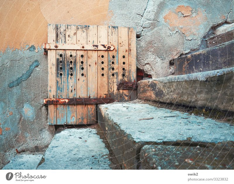 Fitted Wall (barrier) Wall (building) Facade Door Stairs Stone Wood Metal Rust Old Blue Orange Turquoise Decline Past Transience Hinge Locking bar torgau Saxony