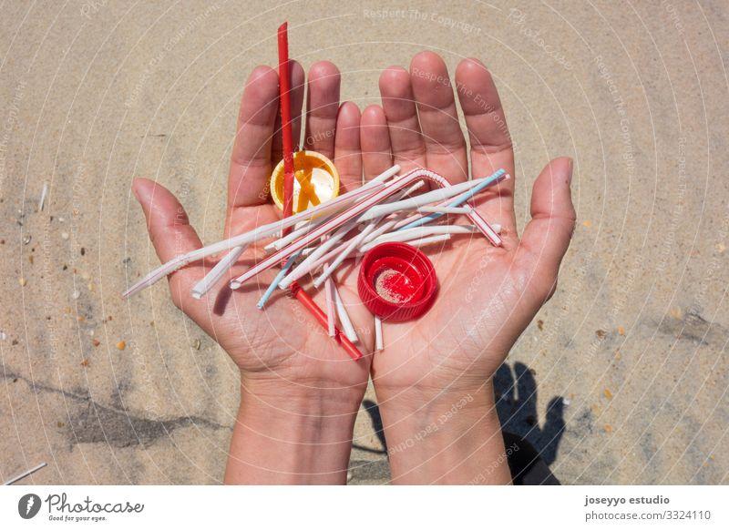 Hands full of plastics on the beach. Activist Awareness Beach care Clean Coast ears sticks Education Environment Free Future lollipops movement Ocean