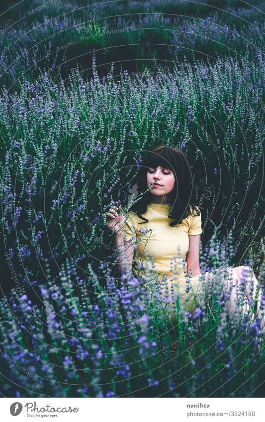 Young brunette woman sitting surrounded by lavender young pretty retro vintage nature natural real candid relax tranquility scene flowers spring springtime