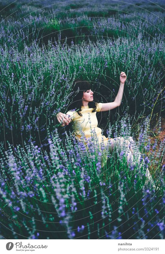Young brunette woman sitting surrounded by lavender Lifestyle Beautiful Relaxation Calm Freedom Summer Human being Feminine Young woman Youth (Young adults)