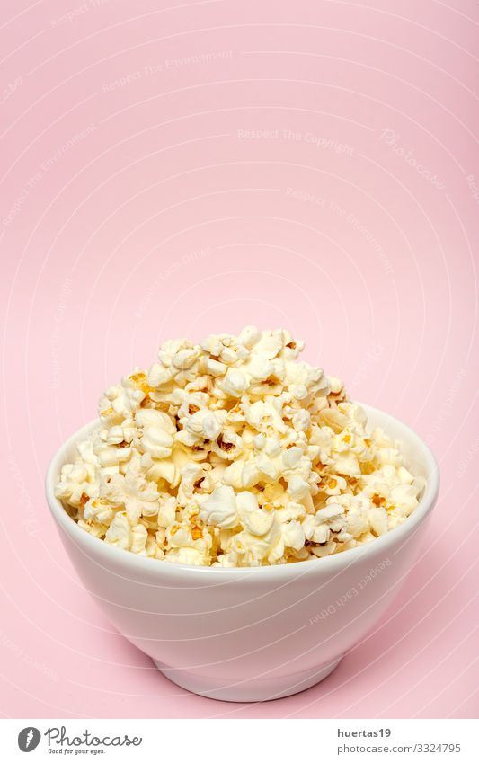 Popcorn on colored backgrounds Food Fast food Bowl Entertainment Cinema Fresh Delicious Pink White Colour Snack Salty movie Classic full pop Tasty isolated