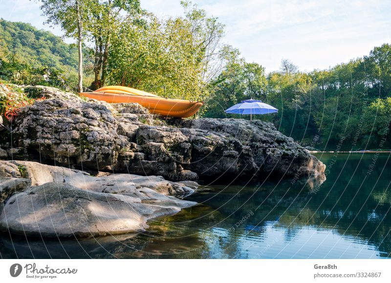 orange boat and blue umbrella by the river in the forest Sky Vacation & Travel Nature Plant Blue Colour Green Landscape Tree Clouds Leaf Mountain Natural Coast