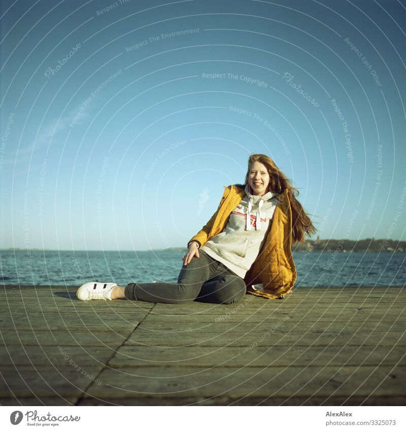 Young woman on a jetty at the Baltic Sea Lifestyle Joy Beautiful Well-being Trip Ocean Youth (Young adults) 18 - 30 years Adults Landscape Water Cloudless sky