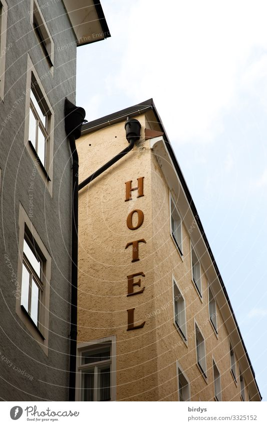 HOTEL Vacation & Travel City trip Town Deserted House (Residential Structure) Hotel Facade Window Characters Inscription Authentic Brown Gray Hospitality