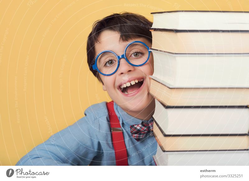 happy and smiling child with books Lifestyle Joy Playing Reading Education Child School Study Schoolchild University & College student Human being Masculine