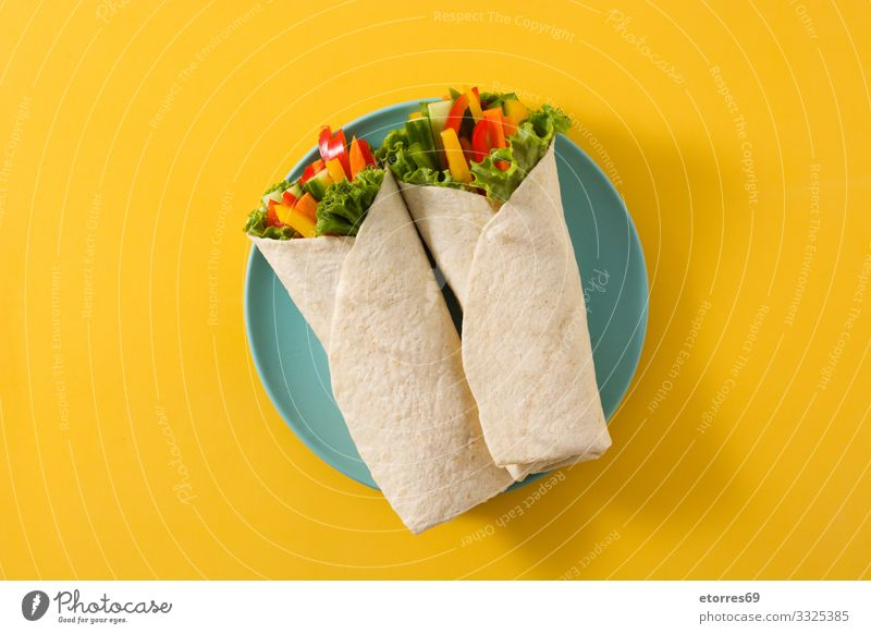 Vegetable tortilla wraps isolated on yellow background. Top view Wrap Roll Flat bread Food Healthy Eating Food photograph Spring Vegetarian diet Mix Carrot