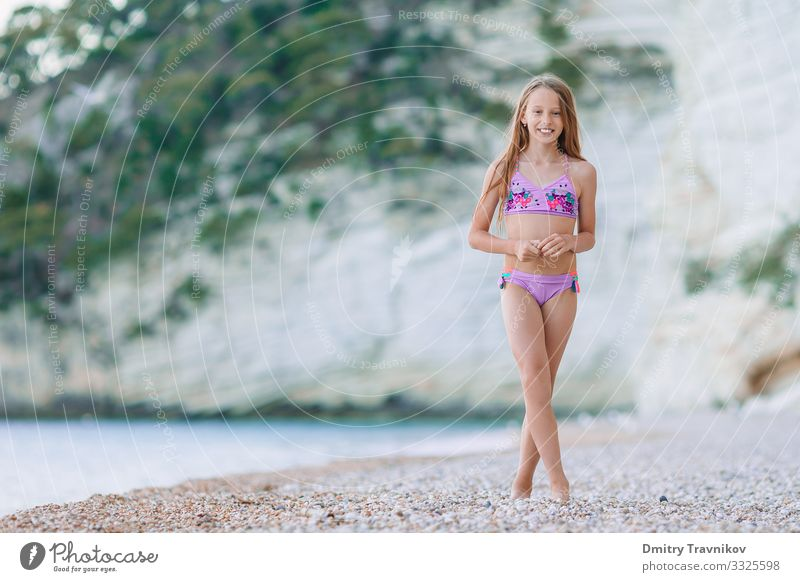 Cute little girl at beach during summer vacation Lifestyle Joy Happy Beautiful Relaxation Leisure and hobbies Vacation & Travel Summer Sun Beach Ocean Island