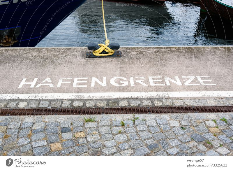 Written | port border Wismar Harbour Fishing boat Stone Characters Signs and labeling Maritime Blue Brown White Watercraft Hull Fastener Rope Strick rope