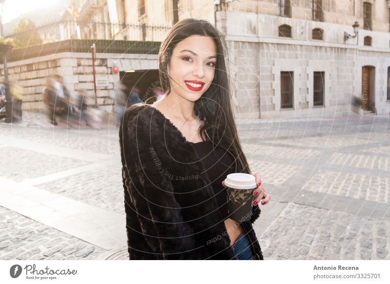 Pretty woman in the street posing with coffee to go Coffee Lifestyle Happy Lipstick Human being Woman Adults Street Fashion Piercing Smiling Loneliness Europe