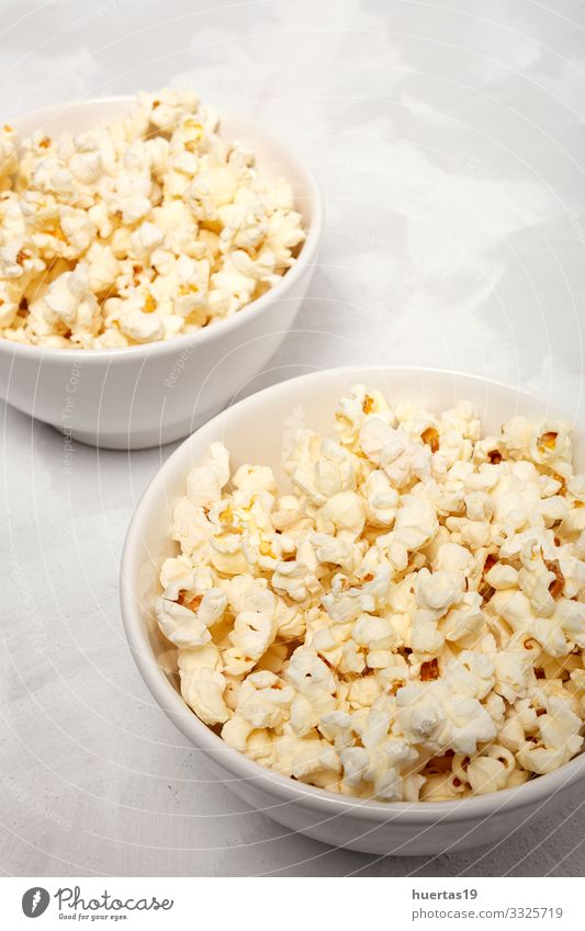 Popcorn on colored backgrounds Food Fast food Bowl Lifestyle Entertainment Cinema Fresh Delicious White Colour Snack Salty movie Classic full pop Tasty isolated