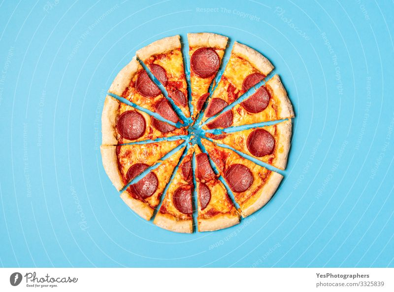 Sliced pizza pepperoni on blue background. Pizza salami slices Food Dough Baked goods Dinner Italian Food Delicious Gold Tradition Mediterranean food above view