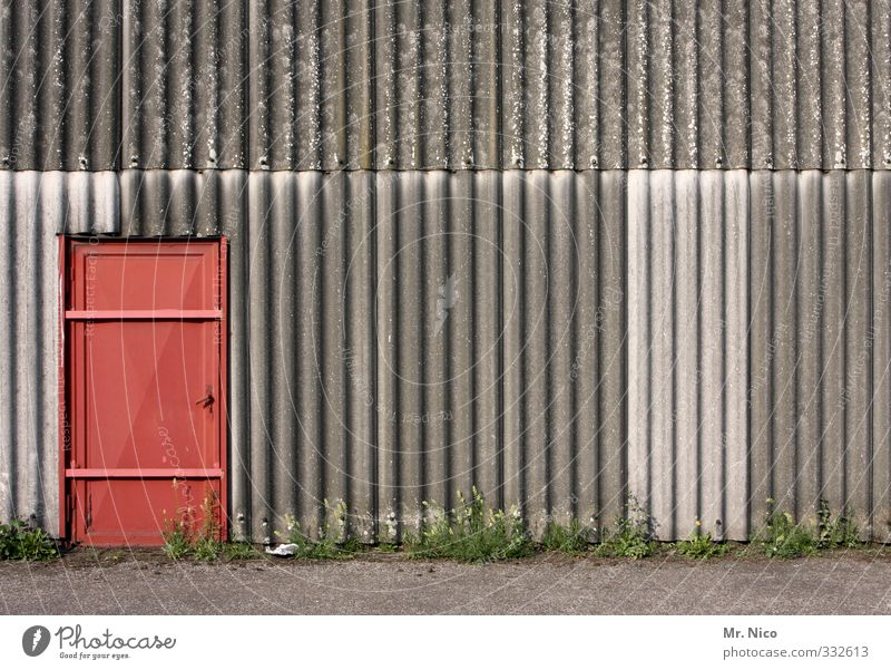 Plant Red Wall (building) Architecture Wall (barrier) Building Work and employment Facade Door Closed Gloomy Simple Factory Hut Gate Entrance
