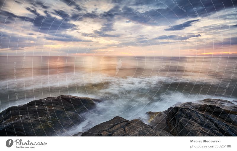 Scenic sunset over water seen from rocky shore. Vacation & Travel Far-off places Freedom Summer Summer vacation Sun Ocean Nature Landscape Sky Horizon