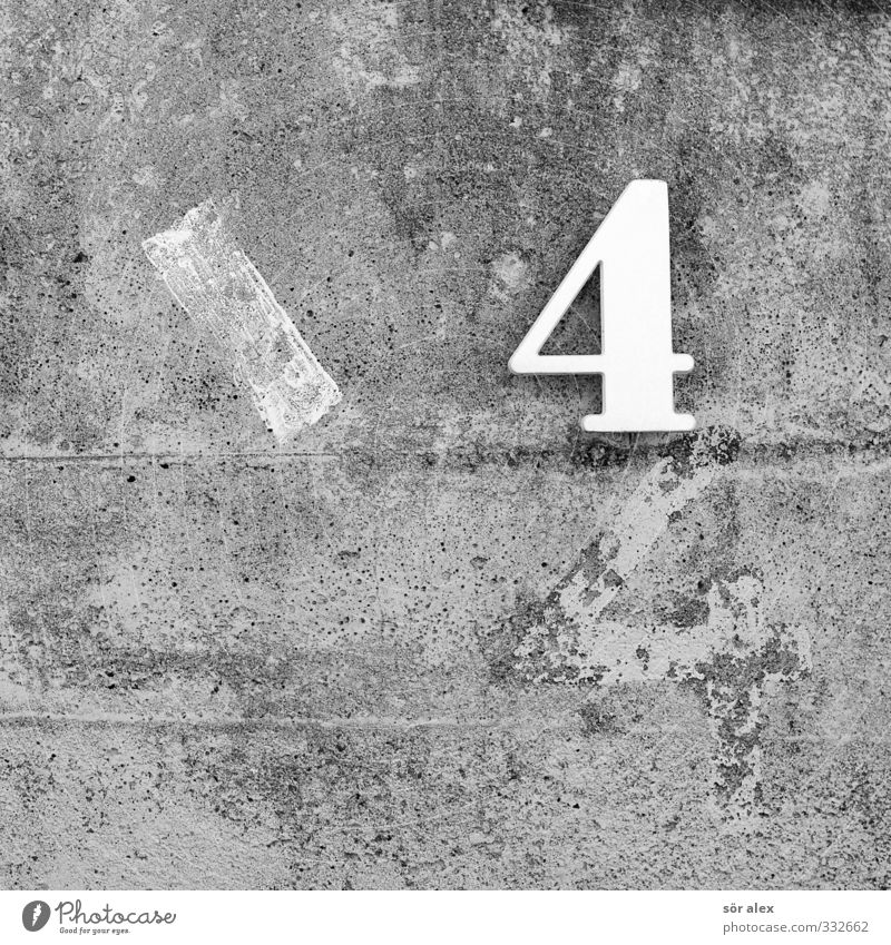 44 Study Wall (barrier) Wall (building) Facade Concrete Concrete wall Sign Digits and numbers House number Gray Mathematics Calculation Colour photo Close-up