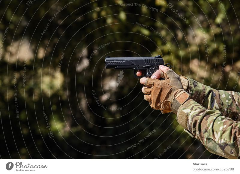 Soldier's hand points with a gun. Military concept. Man Adults War military army training Virtual Weapon background Conceptual design Combat shooting Hold fight