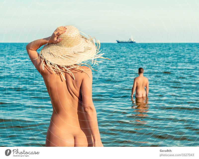 naked girl on the beach and a naked man in the water Skin Vacation & Travel Summer Ocean Island Waves Woman Adults Man Couple Hand Nature Landscape Sky Horizon