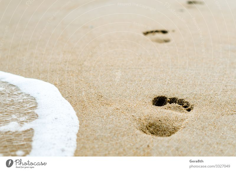 footprints in the sand on the beach near the surf Beach Ocean Waves Wallpaper Nature Sand Footprint Yellow White background foam Tracks Surf water yellow sand