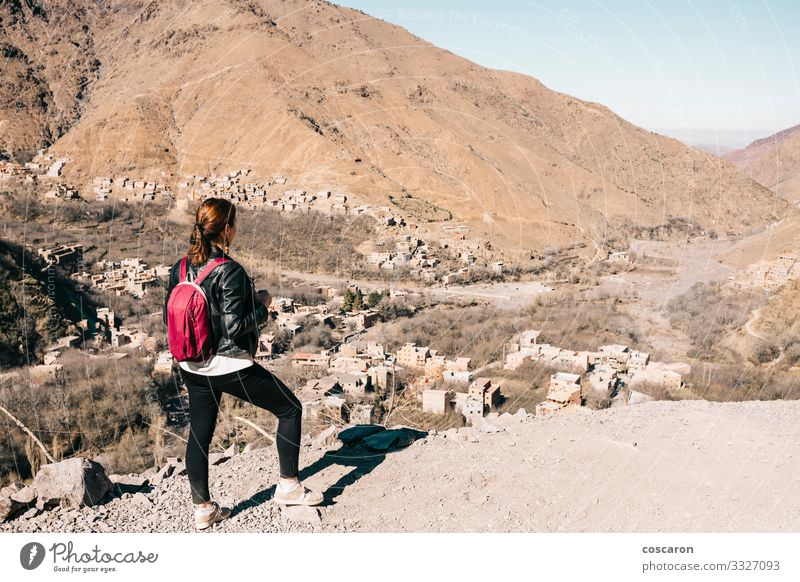 Young tourist hiking in the mountains of Morocco Lifestyle Beautiful Vacation & Travel Tourism Trip Adventure Expedition Sun Mountain Hiking Human being