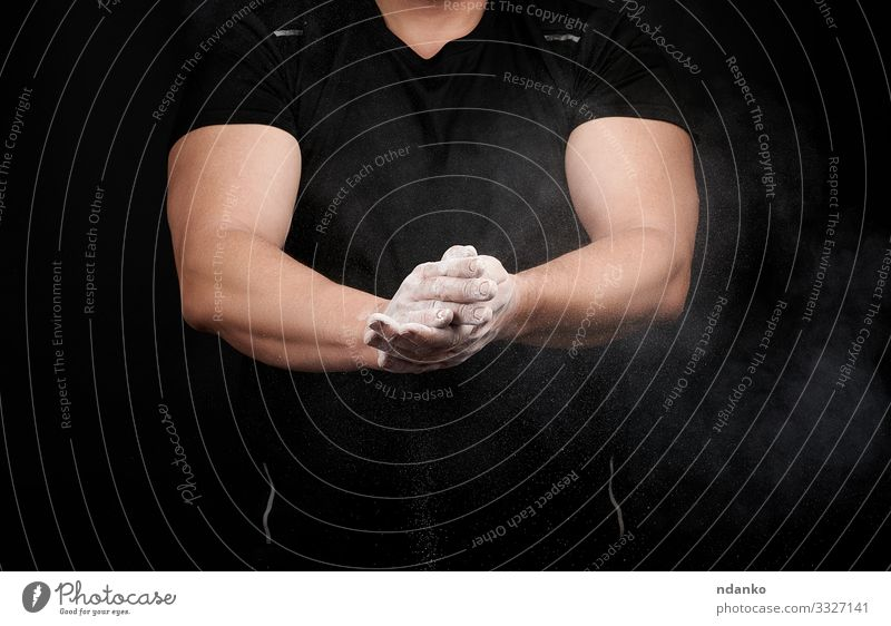 muscular athlete in a black uniform Lifestyle Body Fitness Sports Track and Field Human being Man Adults Hand Fingers Athletic Muscular Strong Black White Power
