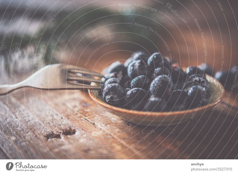 Blueberries with fork Food Fruit Nutrition Breakfast Organic produce Bowl Fork Lifestyle Style Table Stone Wood Eating To enjoy Good Delicious Juicy Brown