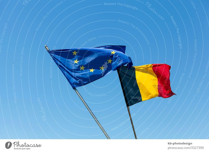 European flag with Belgium flag Germany Sign Flag Vacation & Travel flags Belgian European parliament Houses of Parliament EU blue sky politics economics signs