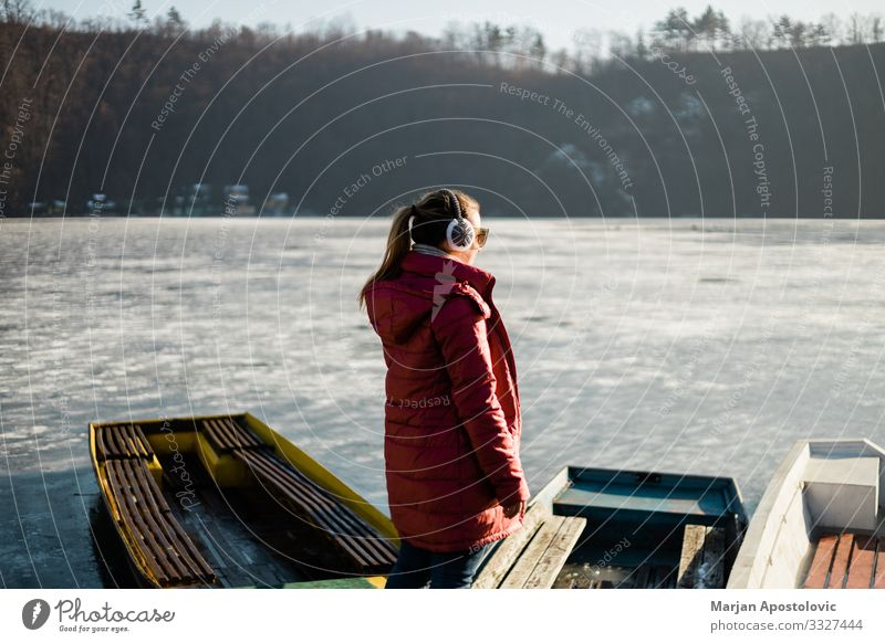 Young woman standing by the frozen lake Freedom Winter Human being Feminine Youth (Young adults) Woman Adults Life 1 30 - 45 years Nature Water Ice Frost