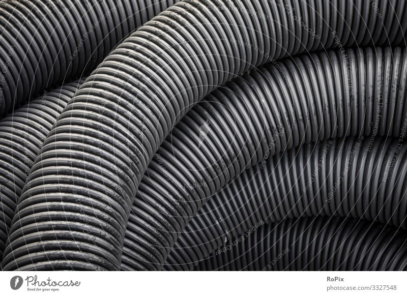 Plastic drainage hose on a construction site. Lifestyle Style Design Science & Research Work and employment Profession Workplace Construction site Factory