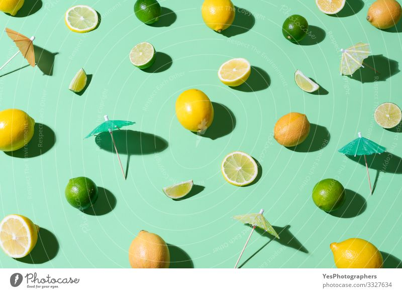 Limes, lemons and cocktail umbrellas. Summer background Food Fruit Beautiful weather Fresh aqua menthe cheerful Citrus fruits cocktail ingredients colorful