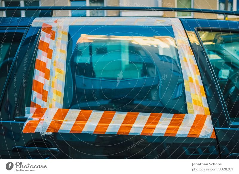 Car windows glued with barrier tape Town Transport Means of transport Passenger traffic Motoring Street Vehicle Anger Destruction Accident Car Window Warn Stick
