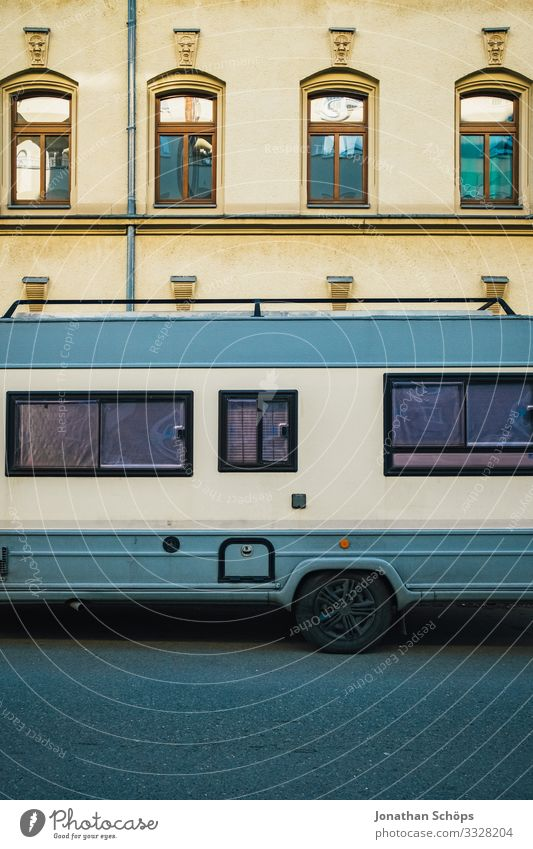 Caravans in the city Town Outskirts House (Residential Structure) Facade Transport Passenger traffic Motoring Street Vehicle Mobile home