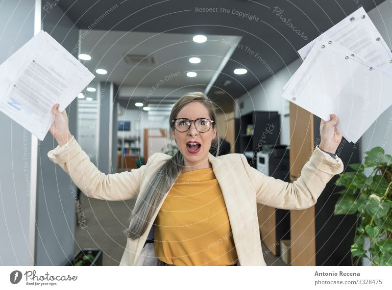 Stressed woman throws papers in the office in an image of relief Relaxation Vacation & Travel Work and employment Profession Workplace Office Business