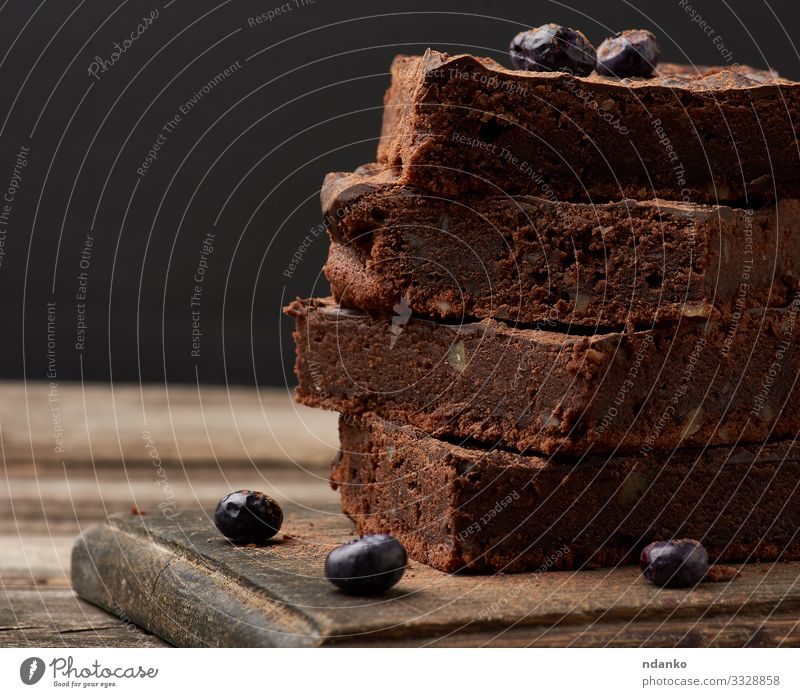 brownie chocolate cake with walnuts Cake Dessert Candy Nutrition Eating Hot Chocolate Table Wood Dark Fresh Delicious Brown Black Tradition cacao Pie piece
