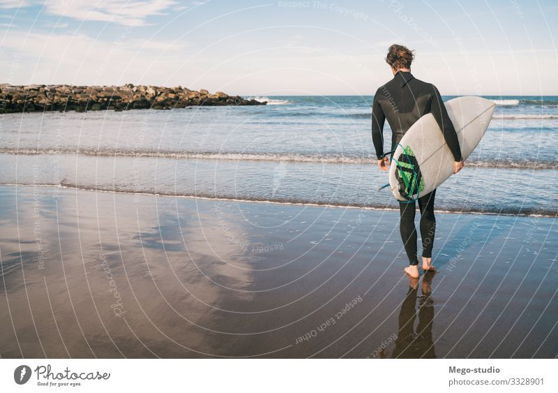 Surfer entering into the water with his surfboard. Lifestyle Joy Relaxation Adventure Beach Ocean Waves Sports Aquatics Human being Masculine Man Adults 1