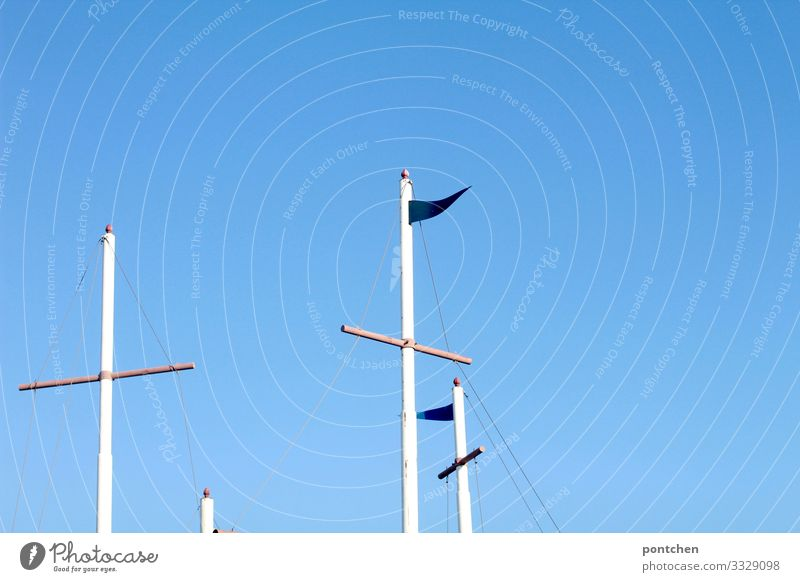 Flagpoles in front of a bright blue sky Beautiful weather Blue White Pole Wind Wood Crucifix Cloudless sky Summer Warmth Freedom Colour photo Multicoloured