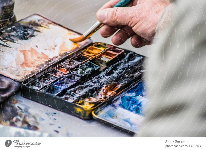 Hand of a painter in front of palette with oil paints Human being Masculine Fingers Art Artist Painter Work and employment Draw Esthetic Blue Brown