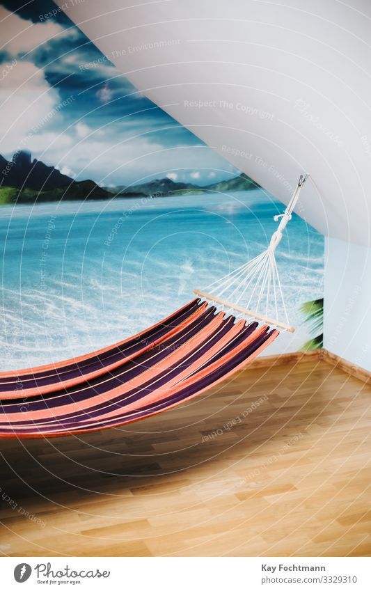 Hammock inside a room with a panorama picture of tropical island on the wall beach calm coast comfort comfortable cozy day dream exotic hammock holiday holidays