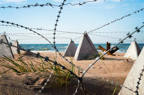barbed wire on the beach near the sea in Crimea Vacation & Travel Beach Ocean Nature Landscape Sand Sky Clouds Coast Concrete Blue White Safety (feeling of) War