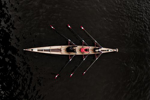 View from above on a double triple 3x rowing boat with three rowers Elegant Joy Rowing Aquatics Human being Feminine 18 - 30 years Youth (Young adults) Adults