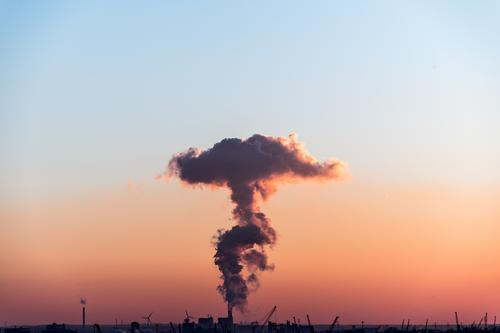 Coal-fired power plant at sunset with a very large cloud of exhaust gas Energy industry Coal power station Industry Cloudless sky Sunrise Sunset Climate change