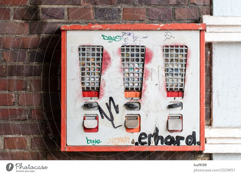 behind bars Building Wall (barrier) Wall (building) Gumball machine Vending machine Graffiti Soviet Union Old Esthetic Famousness Dirty Broken Kitsch Retro Town