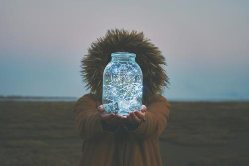 Girl is holding fairy lights in a jar on winter dry landscape Style Winter Decoration Feasts & Celebrations Christmas & Advent Human being Woman Adults Hand