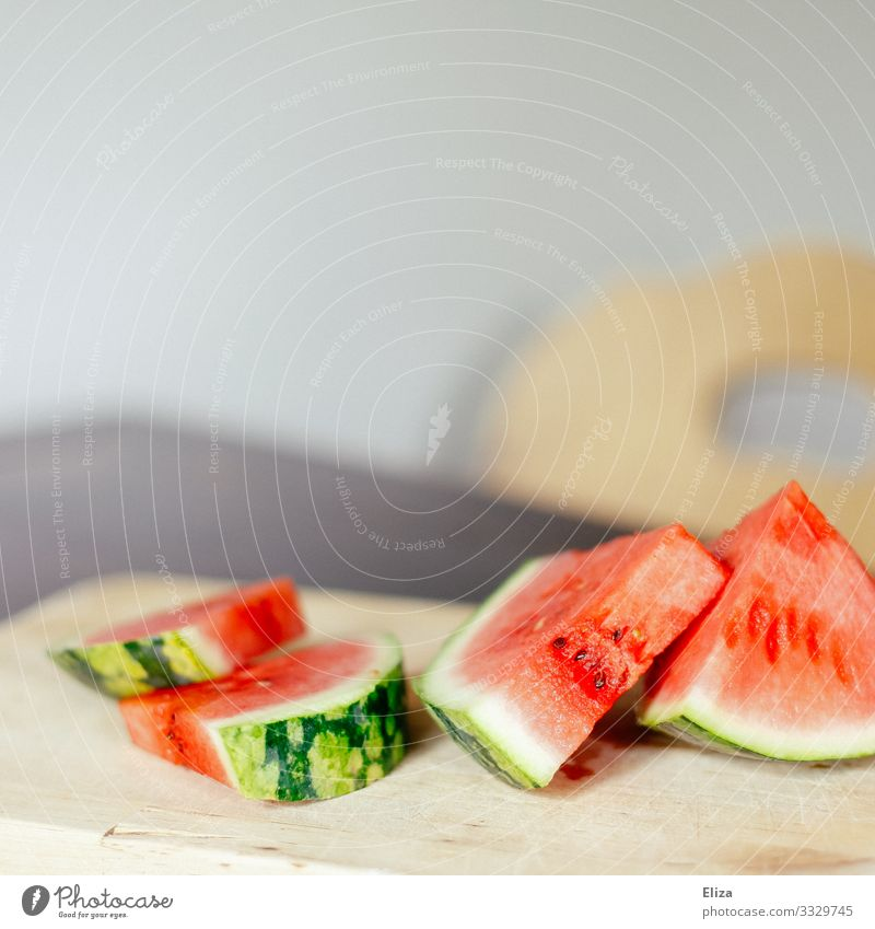 Sliced watermelon on a wooden cutting board on a table Food Fruit Delicious Water melon Wooden board Sweet Fruity Fresh Summery Red Melon Kitchen Table Snack