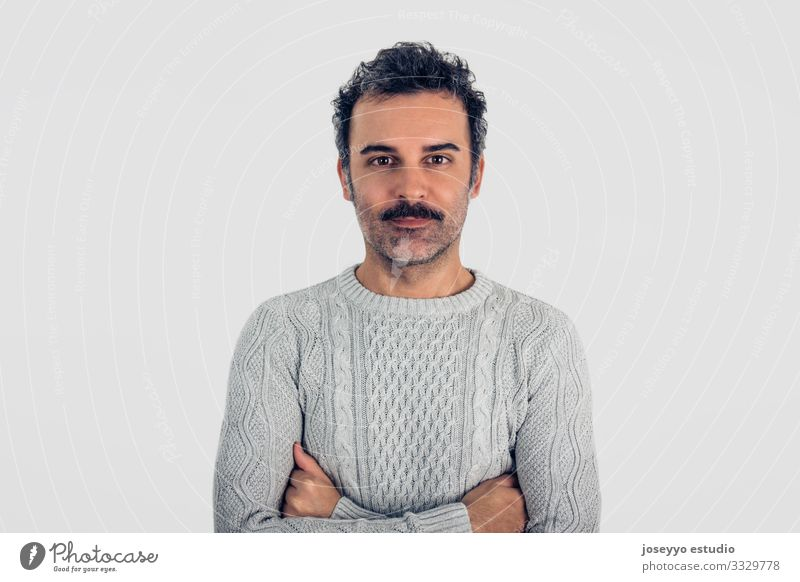 Man with mustache and gray sweater standing with crossed arms. Adults Attractive Brown Cancer Casual clothes Caucasian Self-confident Cool (slang) Copy Space