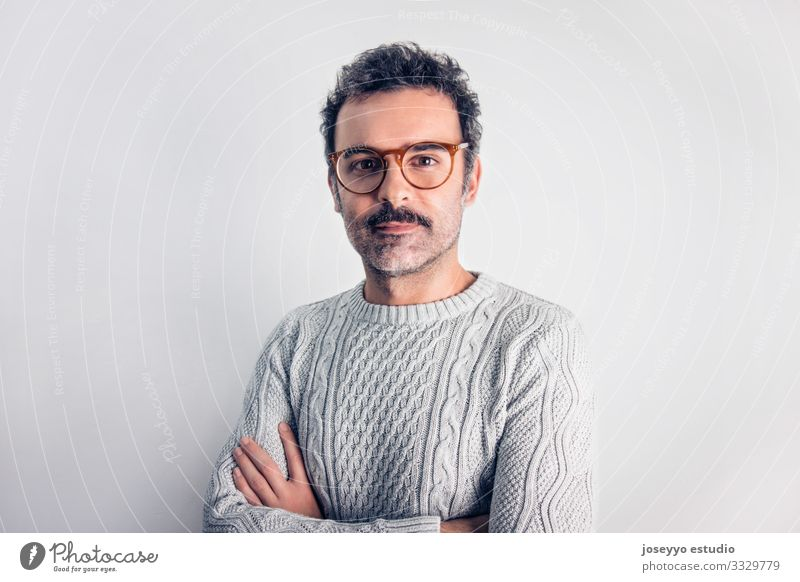 Man with mustache and glasses standing with crossed arms. Adults Attractive Brown Cancer Casual clothes Self-confident Cool (slang) Copy Space Expression Face