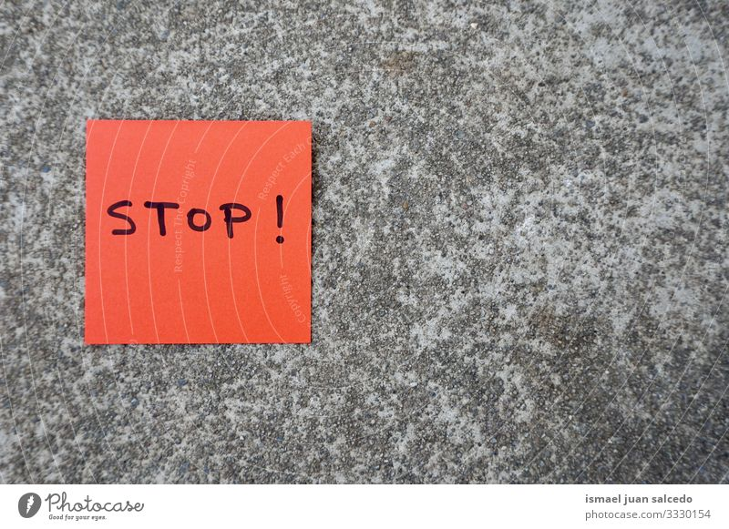 stop handwritten on the red paper on the wall note message sticky isolated sign notice post memo text communication postit word writing letters concept advice